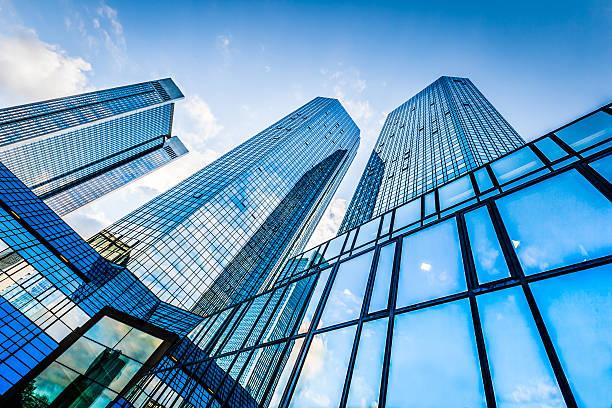 modern skyscrapers in business district against blue sky - bank financieel gebouw stockfoto's en -beelden