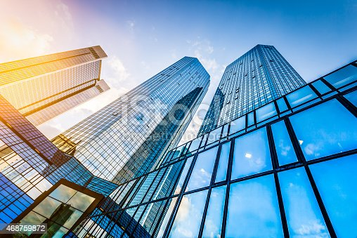 istock Modern skyscrapers in business district at sunset 468759872
