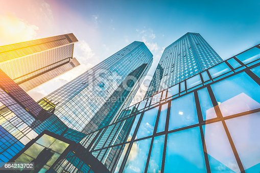 istock Modern skyscrapers in business district at sunset with lens flare effect 664213702