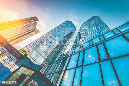 istock Modern skyscrapers in business district at sunset with lens flare effect 672463276