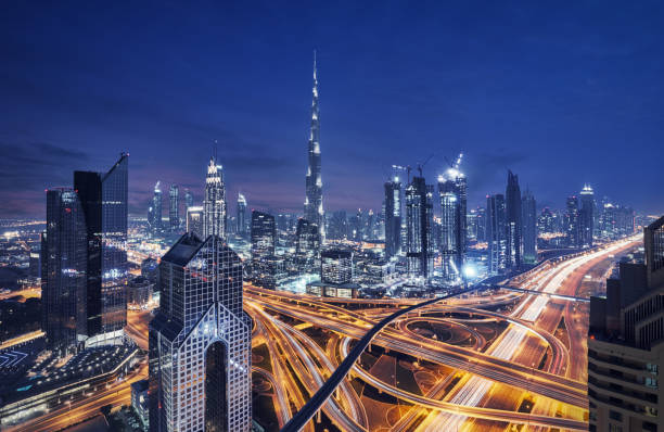 Modern skyscrapers in Downtown Dubai, Dubai, United Arab Emirates Fantastic nighttime skyline of a big city with illuminated skyscrapers burj khalifa stock pictures, royalty-free photos & images