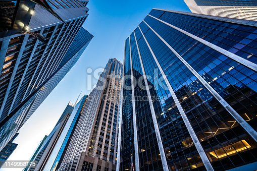 Low angle view of modern skyscrapers in Midtown Manhattan.