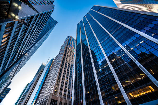 Modern skyscrapers in Midtown Manhattan Low angle view of modern skyscrapers in Midtown Manhattan. skyscraper stock pictures, royalty-free photos & images