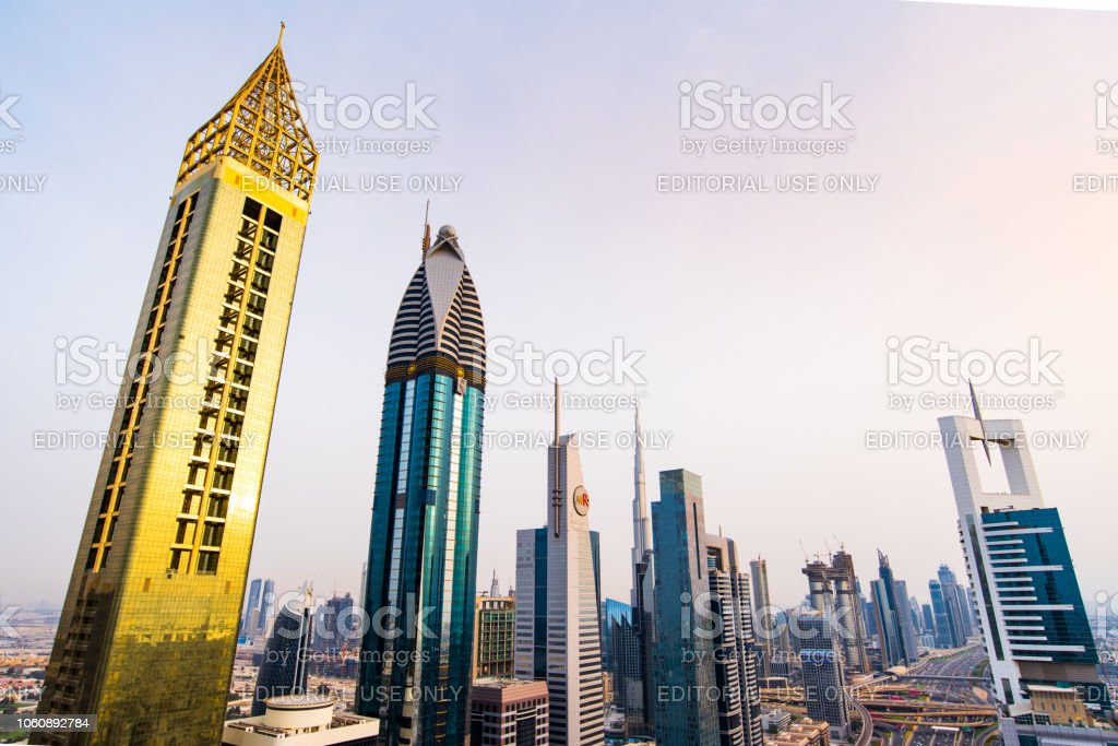 Modern Skyscrapers Of Downtown Dubai From A Rooftop At Sunset Modern