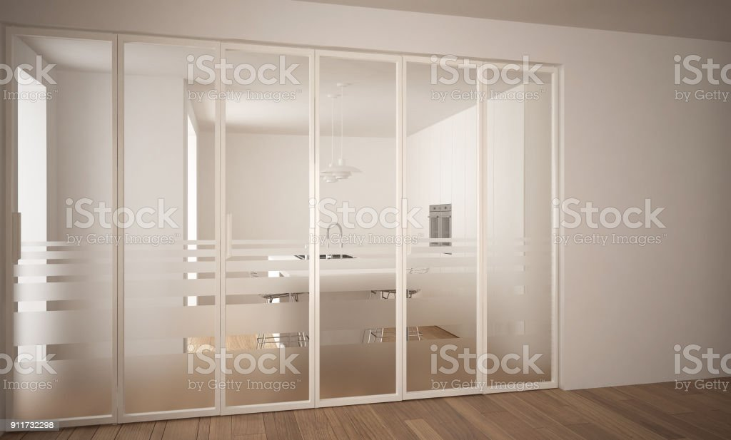 Modern sliding door with kitchen in the background, white minimal architecture interior design stock photo