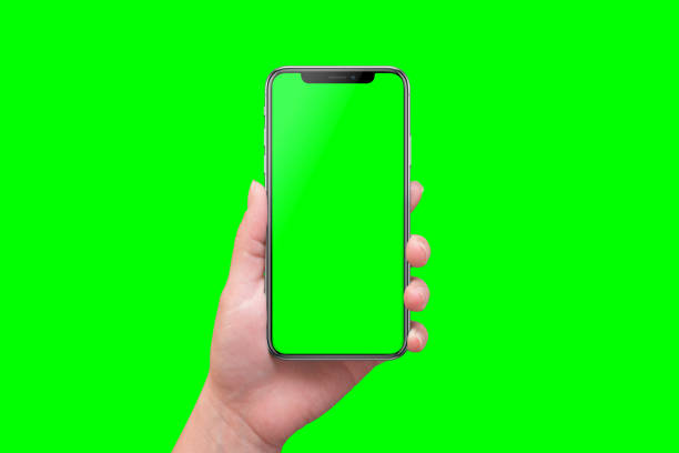 modern smart phone in hand close-up. isolated screen and background in green. - green screen background stock photos and pictures