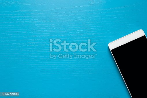 istock Modern smart phone on the blue background. Conversations concept. Mock up for special offers as advertising or other ideas. Empty place for text or a logo. 914755306