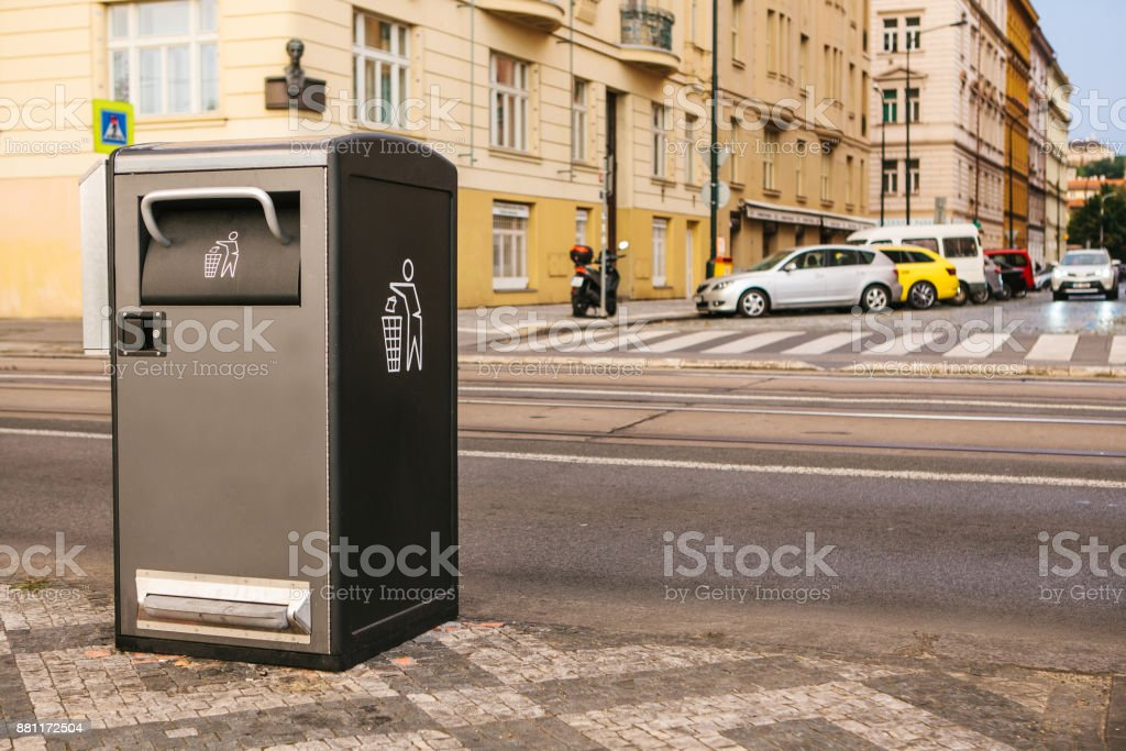 A modern smart trash can on the street in Prague in the Czech Republic. Collection of waste in Europe for subsequent disposal. Eco-friendly waste collection. stock photo