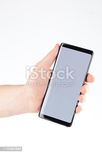 istock Modern smartphone in hand 1125082869