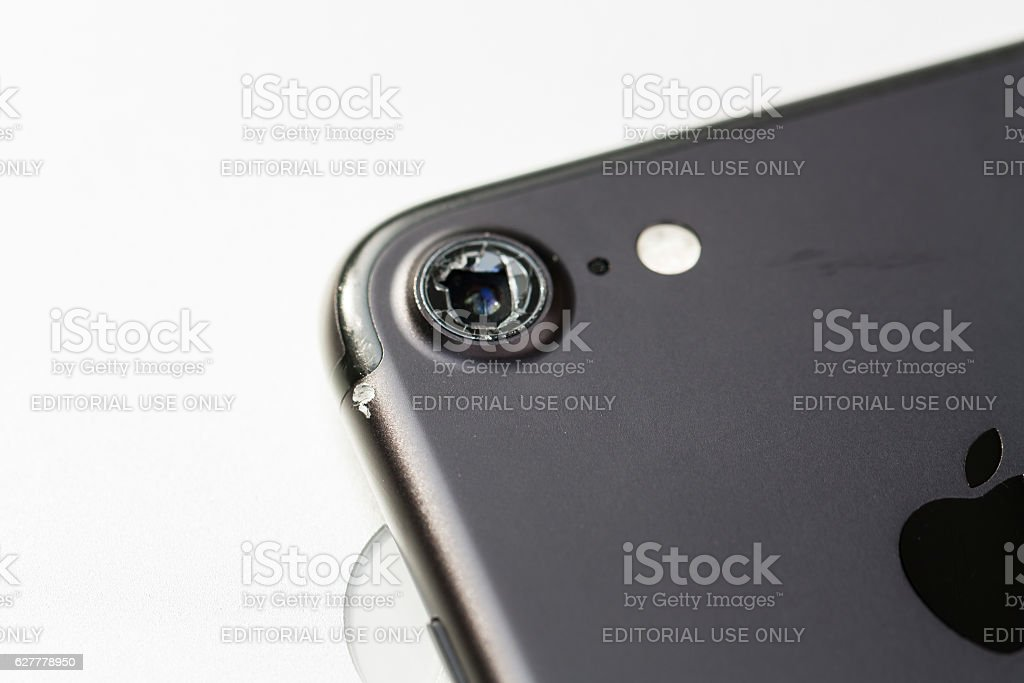 Modern smartphone with damaged camera lens stock photo