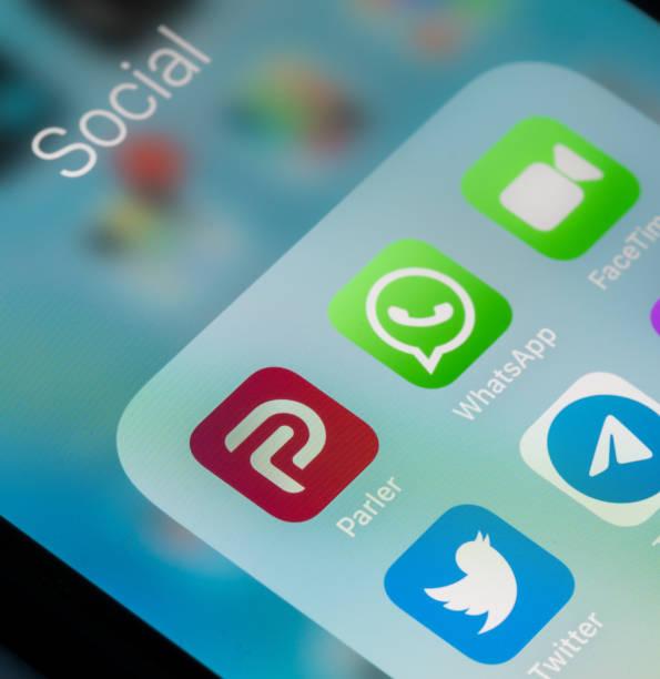 Modern smartphone with Parler social media App stock photo