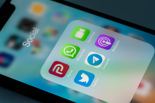 Modern smartphone with Parler social media App replacing Twitter in free speech controversy stock photo
