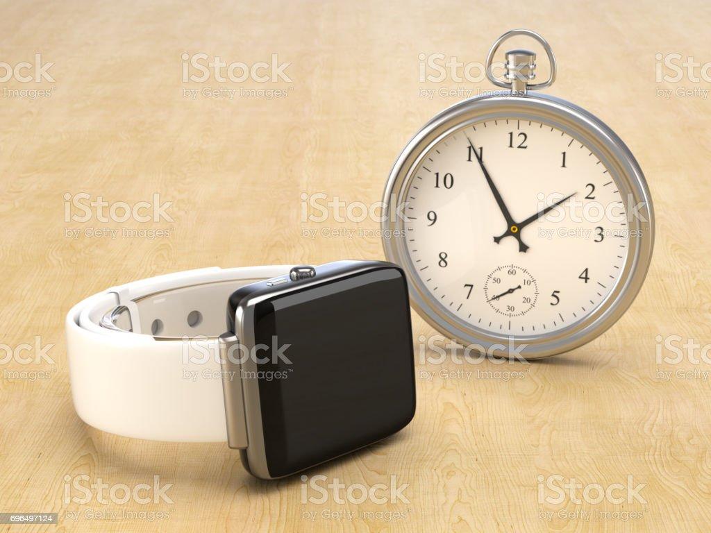 Eine moderne Smartwatch gegen eines Vintage watch – Foto