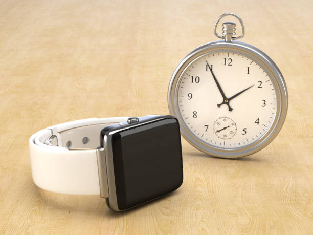 A modern smartwatch against a vintage watch stock photo