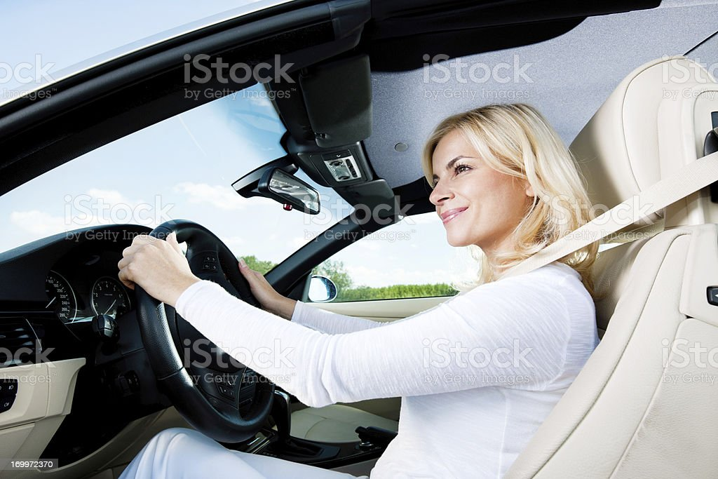 Modern smiling female enjoying in a car ride. royalty-free stock photo