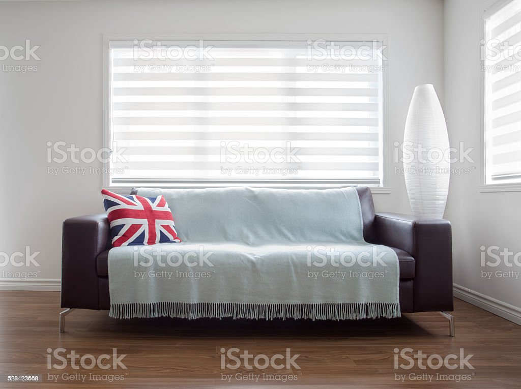 Modern Sofa In Bright Living Room With Zebra Blinds Stock ...