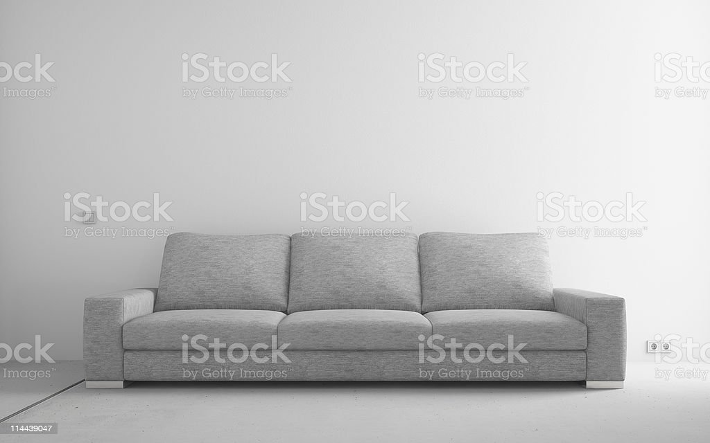 Modern sofa in empty room royalty-free stock photo