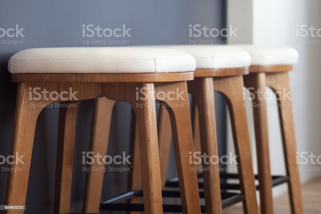 Modern soft dining chairs close up. Chairs near the bar in the kitchen