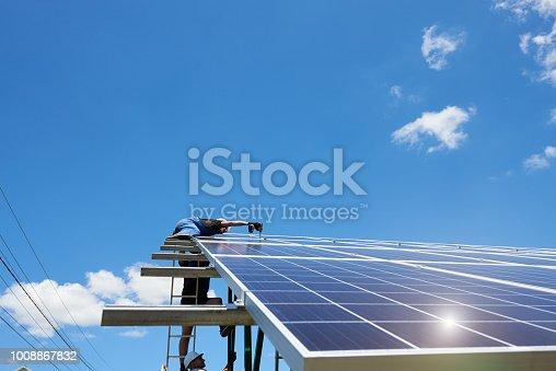 istock Modern solar batteries installed on blue sky background. 1008867832