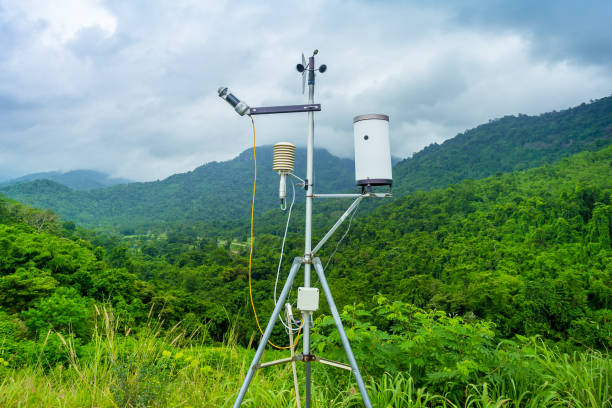 modern solar powered weather station weather with anemometers - rain gauge stock photos and pictures