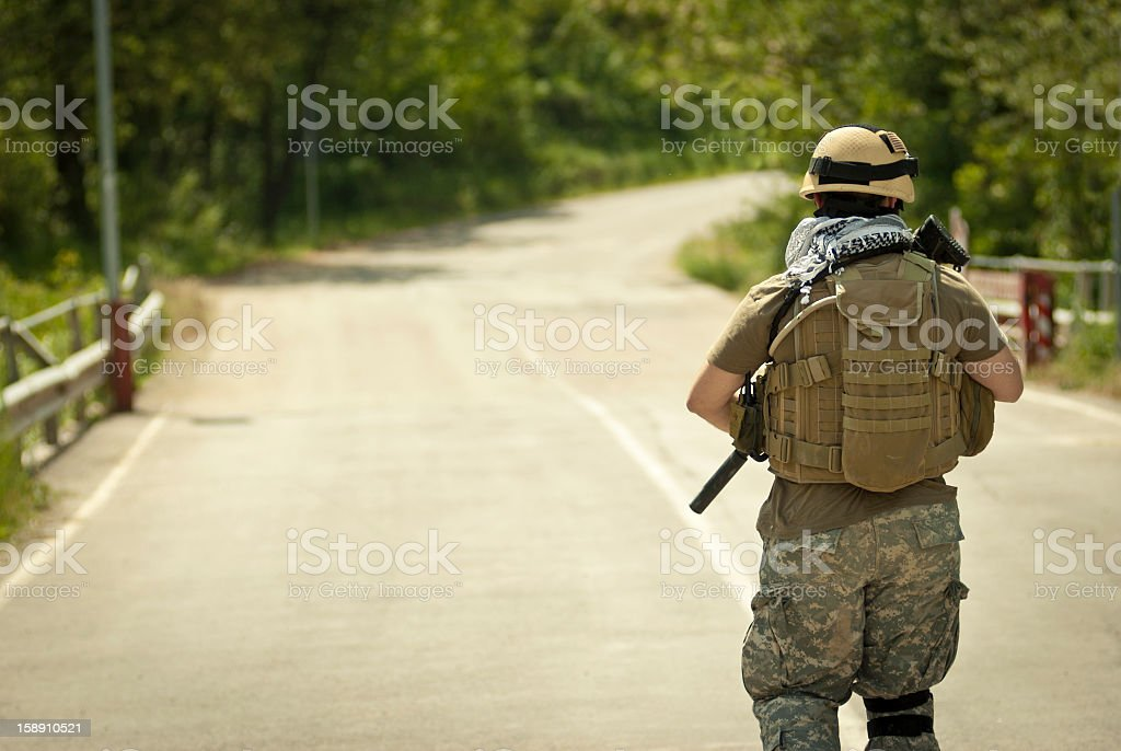 Modern Soldier Patroling Long the Street stock photo