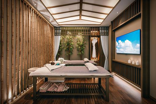 Interior of an empty modern spa massage room.