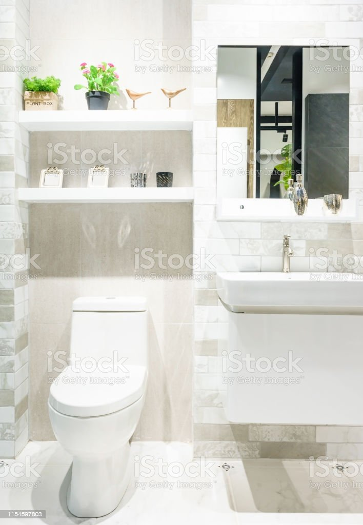 Modern Spacious Bathroom With Bright Tiles With Toilet And Sink Stock Photo Download Image Now Istock