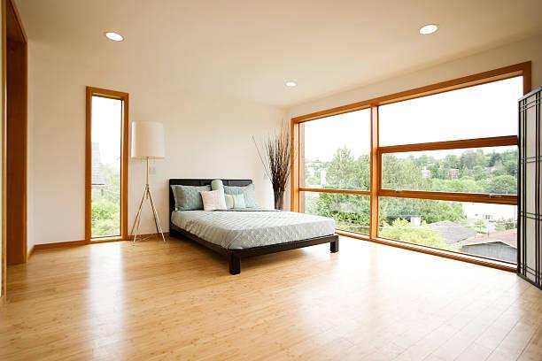 Modern Spacious Bedroom with Hardwood Floors stock photo