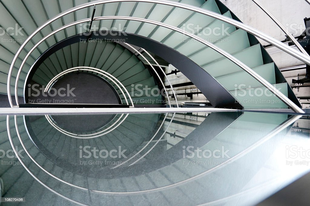 Modern spiral staircase with metal railing foto
