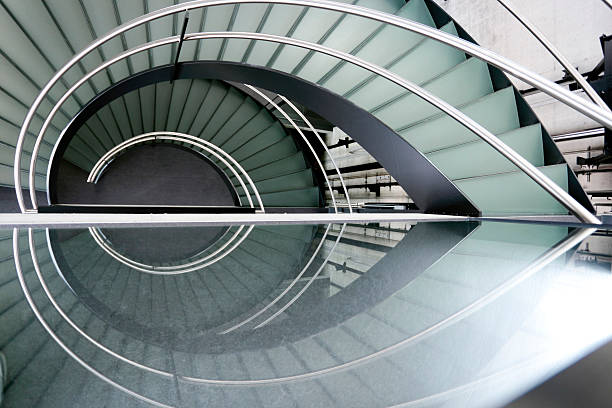 Modern spiral staircase with metal railing stock photo