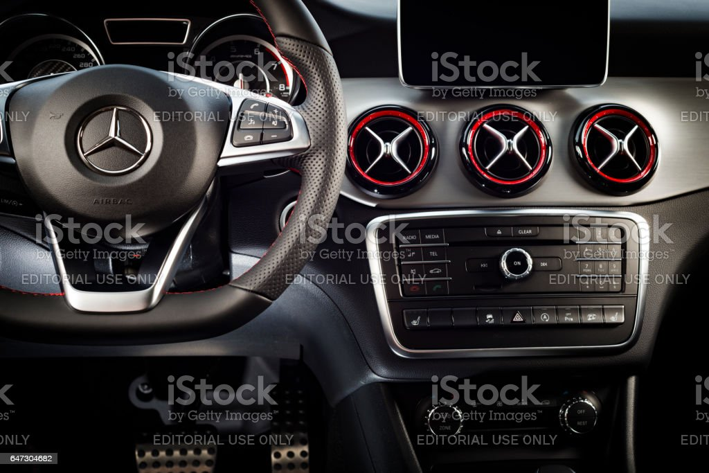 Modern sport car interior Sankt-Petersburg, Russia October 22, 2016 : Dashboard and steering wheel of modern luxury sport car Mercedes-Benz CLA 45 2016 AMG interior, test drive day on October 22, 2016 in Russia. Business Stock Photo