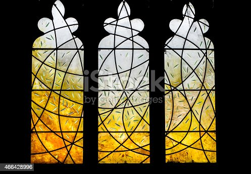 A modern stained glass design n a traditional church window.