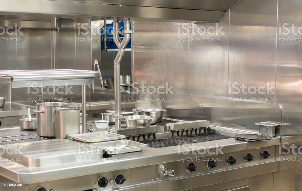 Modern stainless steel hobs in commercial kitchen stock photo