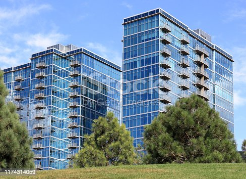 Modern steel and glass buildings with balconies in Denver, Colorado.