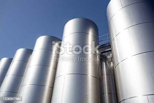 MEUZAC, FRANCE - 17 september 2019 - Modern industrial silo storage tanks for oil, outdoors on a sunny day.