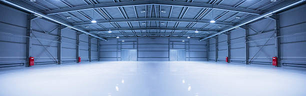 Modern storehouse, background for industry empty room of modern storehouse with gates barn stock pictures, royalty-free photos & images