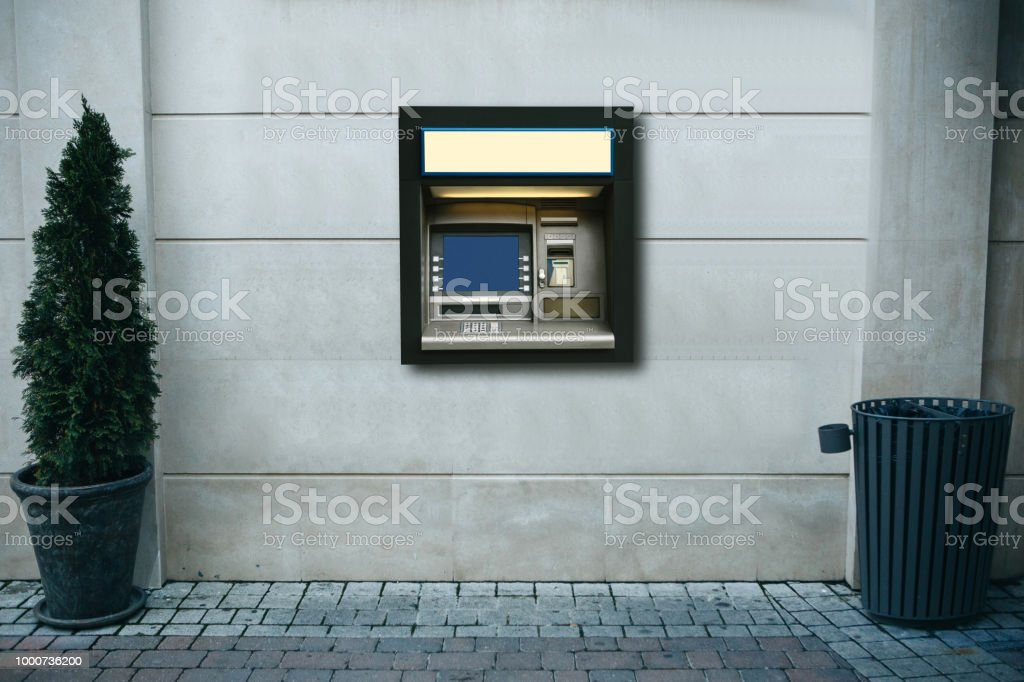 Modern street ATM machine for withdrawal of money and other financial transactions stock photo