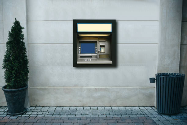 Modern street ATM machine for withdrawal of money and other financial transactions Modern street ATM machine for withdrawal of money and other financial transactions. banks and atms stock pictures, royalty-free photos & images