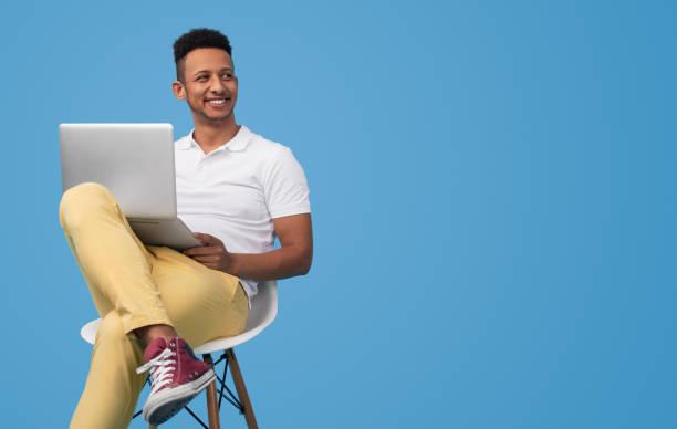 Modern student using laptop near empty space stock photo
