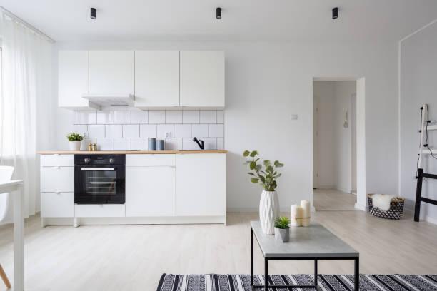 Modern studio apartment with kitchenette stock photo