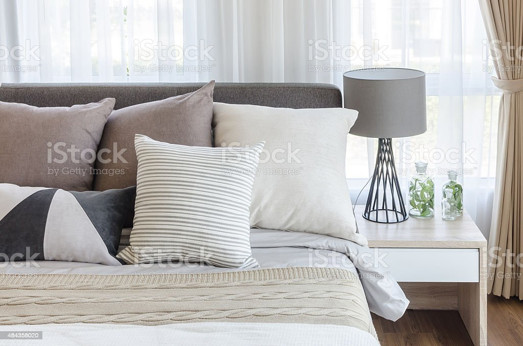 modern style bedroom with pillows on bed stock photo