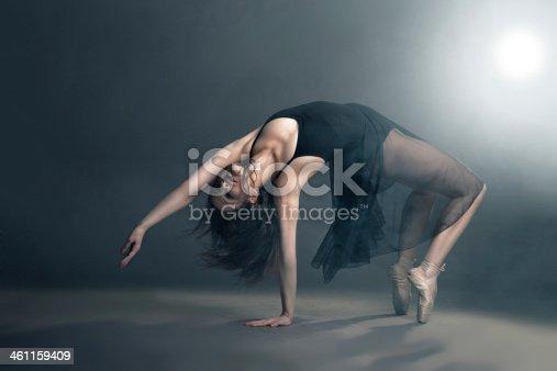istock Modern style dancer posing on grey background 461159409