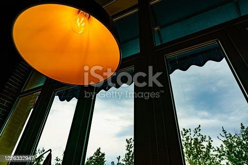 1137999886 istock photo Modern style glowing light bulb 1226332947