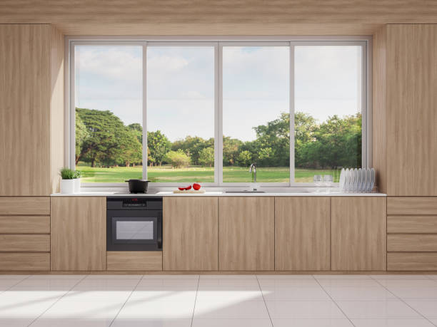 Modern style wooden kitchen with nature view 3d render stock photo