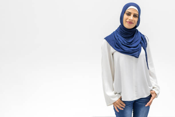 Modern, Stylish and Happy Muslim Woman Wearing a Headscarf Modern, Stylish and Happy Muslim Woman Wearing a Headscarf middle eastern culture stock pictures, royalty-free photos & images