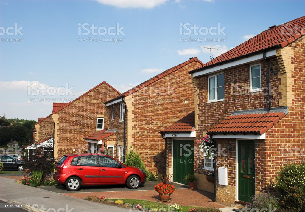 Modern suburban family houses with car on driveway stock photo