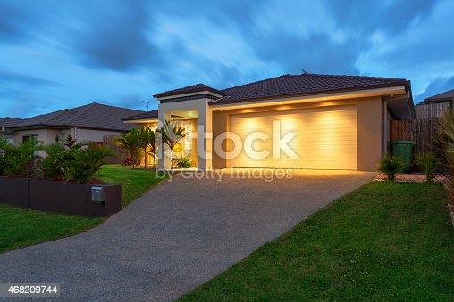 Well lit modern home exterior at dusk