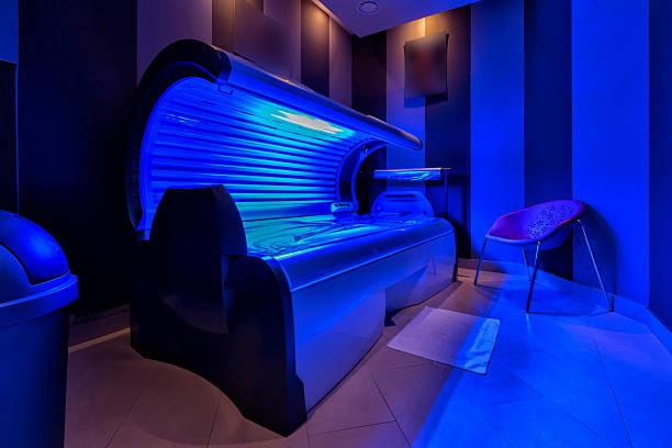 modern sunbed in a beauty salon - gebruind stockfoto's en -beelden