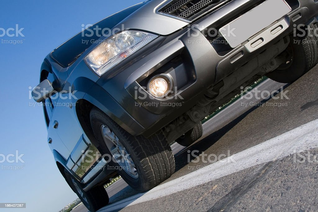 Modern SUV moving with motion blur stock photo