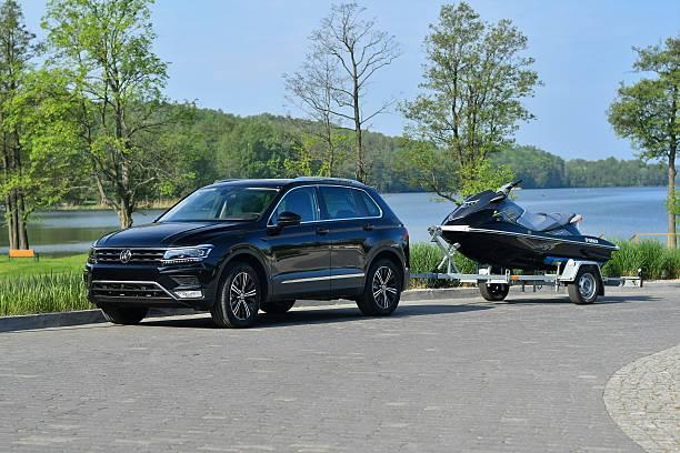 Modern SUV with trailer and jet ski stock photo